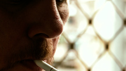 Unshaven Man Lighting Cigarette stock footage