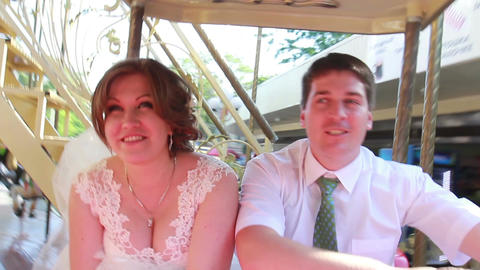 The Bride And Groom Ride On The Carousel On The Wedding Day stock footage