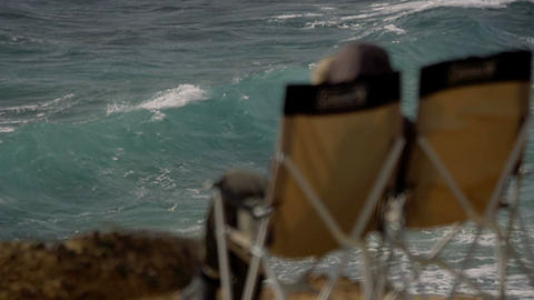200 FPS Real Slowmo, Water Splashing With Two Deck Chairs In Front stock footage