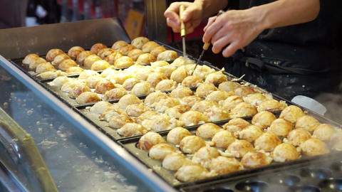 Cooking Takoyaki Japanese Octopus Flour Ball. Traditional Japan Snack Cuisine stock footage