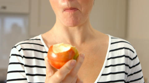 Woman Eating An Apple stock footage