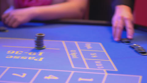 Roulette Table In A Casino - Groupier Pays Out Win For New Game stock footage