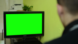 Man Watches TV(television) - Green Screen stock footage