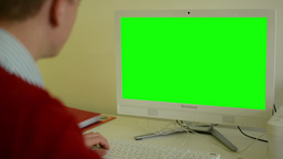 man works on computer - green screen - office - closeup Footage