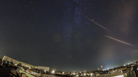 The Milky Way Over A Light Poluted City, Panoramic Rooftop Pan Shot stock footage
