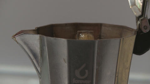 Italian Coffee Spills Out From Moka Close Up stock footage