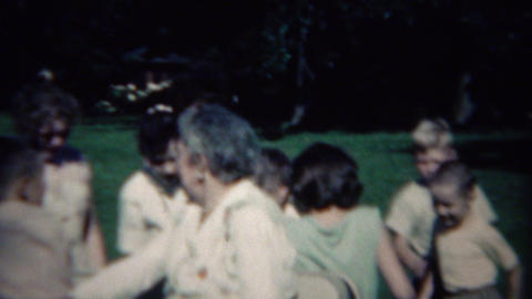 1961: Grandma Driving Happy Kids In Golf Around Retirement Home stock footage