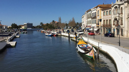 Timelapse Of Traditional Boats And People On The Central Canal Aveiro Portugal stock footage