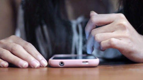 Soft Focused Young Girl Browsing Smartphone stock footage