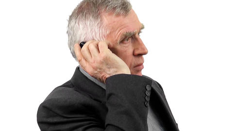 Businessman Talking On His Mobile Phone. Isolated On White Background stock footage