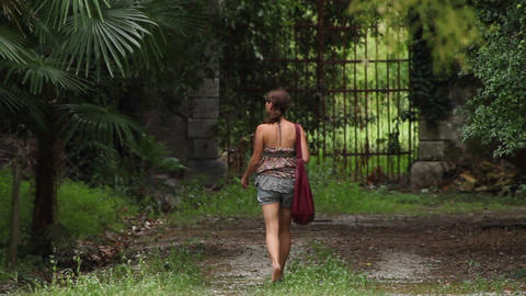 Girl Walking Alone On A Path stock footage
