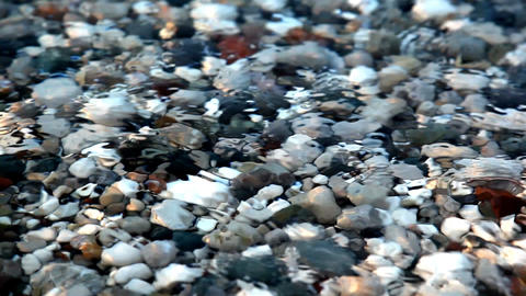 Shot In HD With Macro Focus On Pebbles As Surf Washes Over Beach At Sunset.High  stock footage