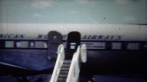 1954: Pilot confidently standing on Pan American Airlines airplane Footage