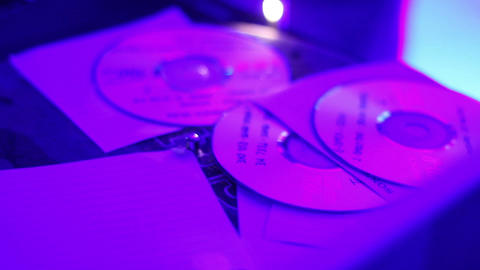 Hands Of DJ Take Disks From The Deck During Performance In Night Club stock footage