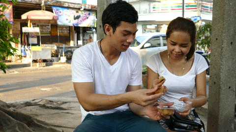 Guy And Girl Tasting Khanom Wan Thai stock footage