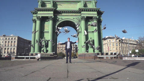 Man At The Square With Many Pigeons stock footage