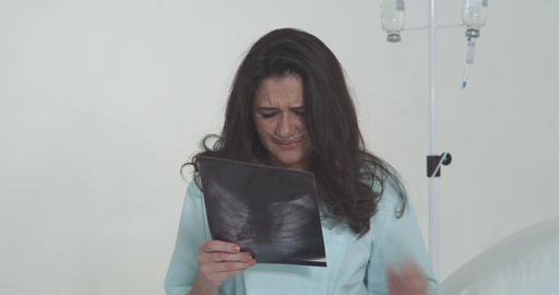Despairing Woman Looking At X-Ray Photo Footage