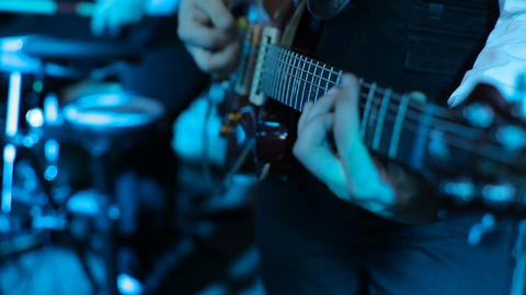 Man Playing A Guitar At A Rock Concert. Guitar Close Up. Guitarist Playing At A  stock footage