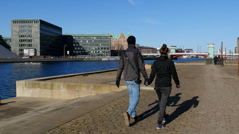 Couple Walking Hand In Hand Along The Harbor stock footage