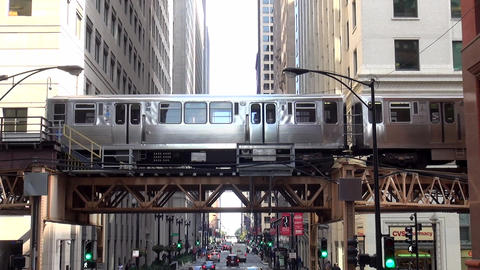 Chicago Metro subway running outside between buildings - CHICAGO, ILLINOIS/USA Footage