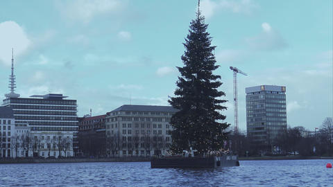 Floating Christmas Tree On Binnenalster In Hamburg - HAMBURG, GERMANY DECEMBER 2 stock footage