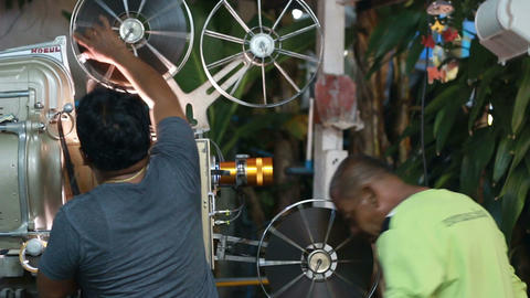 PHUKET THAILAND - MARCH 10, 2015: Old Film Movie Projector Projecting Playing At stock footage