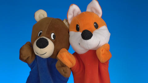 Funny Soft Puppets Toys On Blue Background stock footage