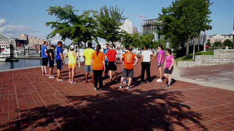 Exercise team prepareing for jogging, Baltimore Footage