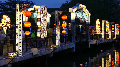 The Cau An Hoi Bridge In The Evening With Floating Lanterns In The Water stock footage