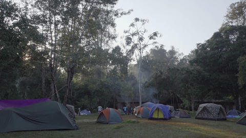 People Have Rest Near The Tent At Campsite stock footage