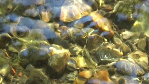 Water Stream Flowing And Rocks At The Bottom In The Sun stock footage