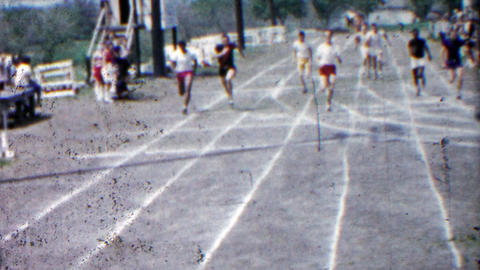 1958: High School Boys Running Track End Race Finishing Line Fast stock footage