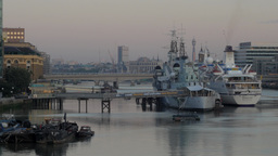 The Warship And Museum HMS Belfast With The German Cruise Liner Berlin Moored Al stock footage