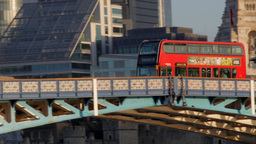 Camera Tracks A Red London Bus Passing Over Tower Bridge On A Sunny Autumn Morni stock footage