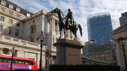 Static shot of the statue of the Duke of Wellington with the Bank of England Beh Footage