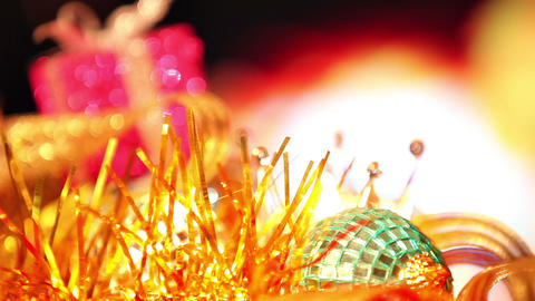 Christmas Gift And Candle On Defocused Lights Background stock footage