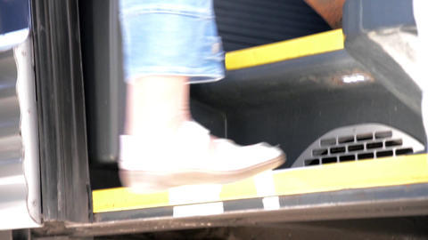 Legs Of The Passengers Who Climb The Few Steps To The Entrance Of The Bus 17 stock footage