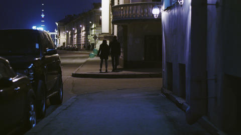 A Young Couple Walking On The Night Street With Air Balloons stock footage