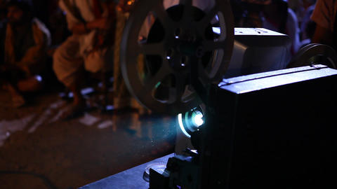 old projector showing film at village Footage
