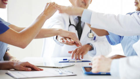 Group Of Happy Doctors With Hands On Top At Clinic stock footage