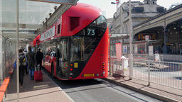 New Routemaster Bus Pulls Into Victoria Bus Station In Central London stock footage