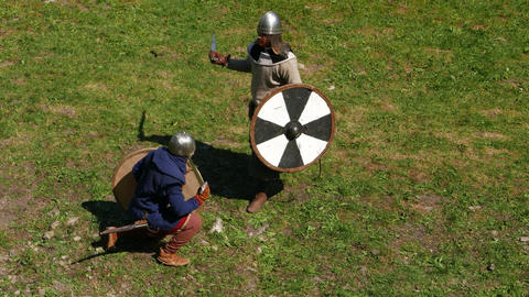 Two Viking Warriors Fight On Swords, One Man Hit From Above And Win Short Duel stock footage