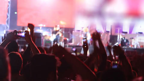 Fans Jumping And Raising Hands At Concert stock footage