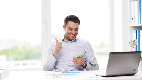 Happy Businessman With Money And Laptop In Office stock footage