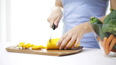 Close Up Of Young Woman Chopping Squash At Home stock footage