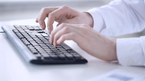 Male Doctor Hands Typing On Keyboard stock footage
