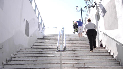 Family With Small Child And A Baby Stroller Up The Steps From The Exit Of Underg stock footage