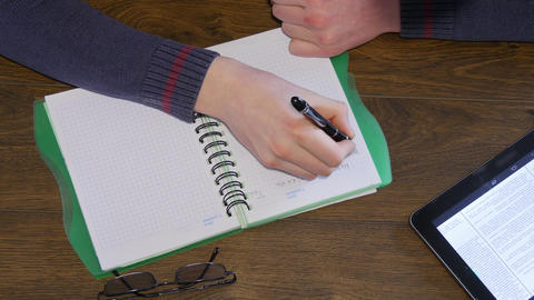 Man Hand Writing On Notepad stock footage