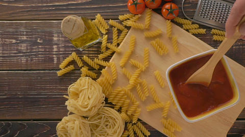 Pasta and ingredients on the wooden table Footage