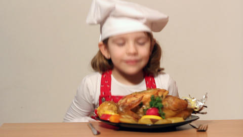 Little Girl Cook With Grilled Chicken stock footage